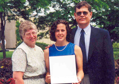 Sarah with her parents on graduation day from Northwestern University, 1999
