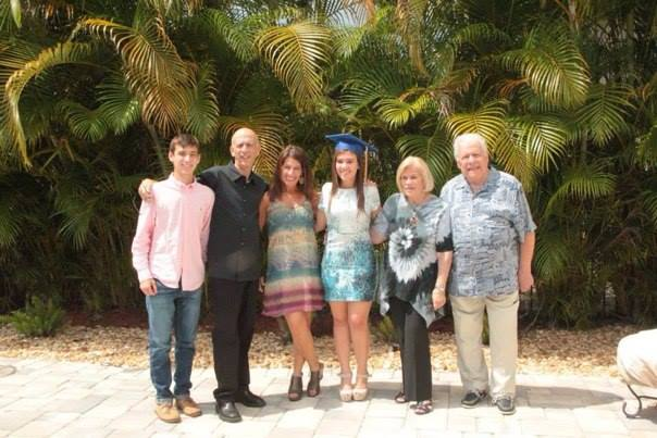 Barry, second from the left, celebrating his daughter's graduation in May, 2015.