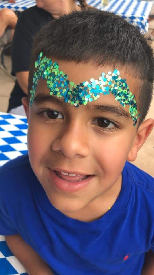 Face painting makes for big smiles at Oktoberfest 2019.